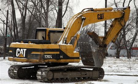 A Caterpillar excavator machine is seen at a work site in Detroit, Michigan January 25, 2013. REUTERS/ Rebecca Cook