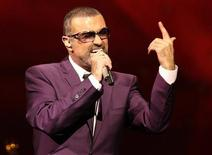 """British singer George Michael performs on stage during his """"Symphonica"""" tour concert in Vienna September 4, 2012. REUTERS/Heinz-Peter Bader"""