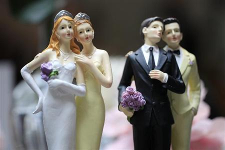 Same-sex couple plastic figurines are displayed during a gay wedding fair (salon du mariage gay) in Paris April 27, 2013. REUTERS/Gonzalo Fuentes