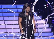 """Finalist Candice Glover reacts following her performance after being announced the winner during the Season 12 finale of """"American Idol"""" in Los Angeles May 16, 2013. REUTERS/Phil McCarten"""