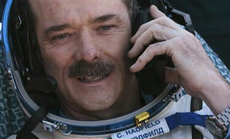 Canadian astronaut Chris Hadfield speaks on the phone after the Russian Soyuz space capsule landed some 150 km (90 miles) southeast of the town of Zhezkazgan, in central Kazakhstan May 14, 2013. REUTERS/Mikhail Metzel/Pool
