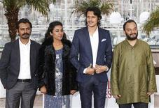 Cast members Nawazuddin Siddiqui, Tannishtha Chatterjee, Vijay Varma and director Amit Kumar pose during a photocall for the film 'Monsoon Shootout' at the 66th Cannes Film Festival in Cannes May 18, 2013. REUTERS/Regis Duvignau