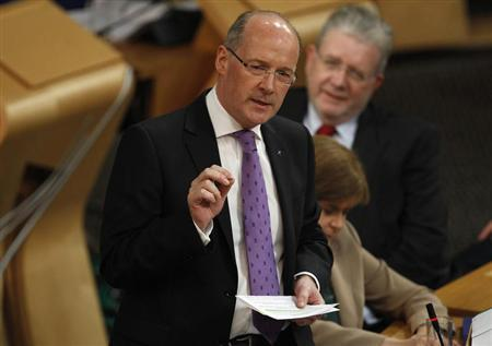 Scotland's Finance Secretary John Swinney gestures during his draft budget address in the debating chamber of the Scottish Parliament in Edinburgh, Scotland September 20, 2012. REUTERS/David Moir (BRITAIN - Tags: POLITICS BUSINESS) - RTR386ZH