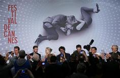 (L-R) Cast members Garrett Hedlund, Justin Timberlake, Carey Mulligan, directors Joel and Ethan Cohen, cast member Oscar Isaac, and musician T-Bone Burnett are pictured by journalists as they arrive to attend a news conference for the film 'Inside Llewyn Davis' during the 66th Cannes Film Festival in Cannes May 19, 2013. REUTERS/Yves Herman