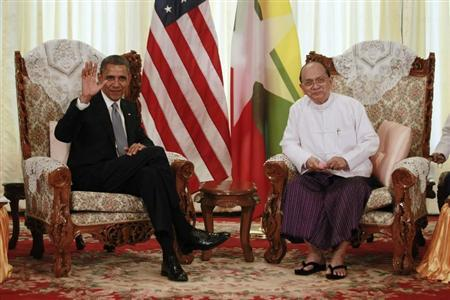 U.S. President Barack Obama (L) waves to the press during his meeting with Myanmar's President Thein Sein in Yangon, November 19, 2012. REUTERS/Jason Reed