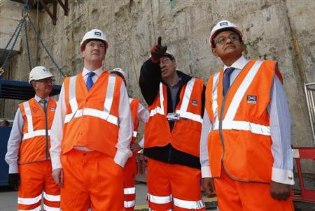 Britain's Finance Minister George Osborne (2nd L) and his Indian counterpart, Palaniappan Chidambaram (R), visit the Pudding Mill Lane Crossrail construction site, in east London May 16, 2013. REUTERS/Lefteris Pitarakis/pool