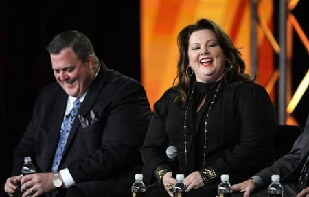 Cast members Billy Gardell (L) and Melissa McCarthy participate in a panel for CBS series ''Mike & Molly'' during the CBS sessions at the Television Critics Association winter press tour in Pasadena, California January 11, 2012. REUTERS/Phil McCarten