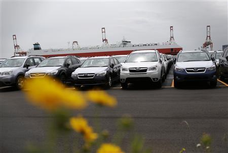 Newly produced cars ready for shipment are parked at a port in Yokohama, south of Tokyo May 21, 2013. REUTERS/Toru Hanai