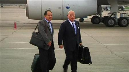 Japanese Cabinet Secretariat Advisor Isao Iijima (R) arrives at Pyongyang airport, in this May 14, 2013 screen grab taken by a video from KCNA. REUTERS/KCNA For Reuters TV