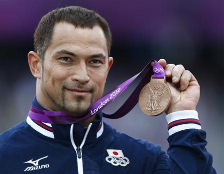 Japan's Koji Murofushi holds his bronze medal during the men's hammer throw victory ceremony at the London 2012 Olympic Games at the Olympic Stadium August 6, 2012. REUTERS/Eddie Keogh/Files