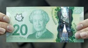 The Canadian 20 dollar bill made of polymer is displayed at the Bank of Canada in Ottawa May 2, 2012. REUTERS/Chris Wattie