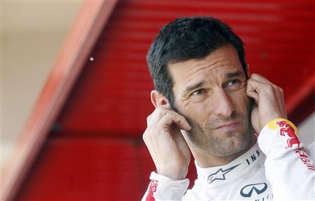 Red Bull Formula One driver Mark Webber of Australia cups his ears during the qualifying session at the Spanish F1 Grand Prix at the Circuit de Catalunya in Montmelo, near Barcelona May 11, 2013. REUTERS/Albert Gea/pool