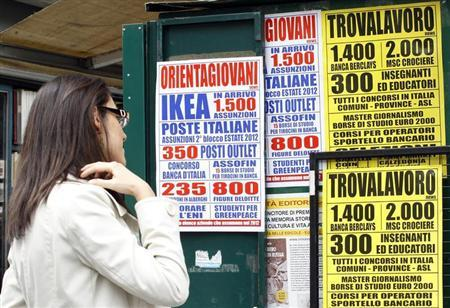 A woman checks job offers in downtown Milan April 3, 2012. REUTERS/Alessandro Garofalo