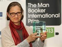 U.S. author Lydia Davis poses after winning the Man Booker Prize at the V&A Museum in London May 22, 2013. REUTERS/Luke MacGregor