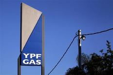 A sign with the YPF Gas logo is seen outside a gas distributor in Moreno, Buenos Aires province, April 19, 2012. REUTERS/Marcos Brindicci