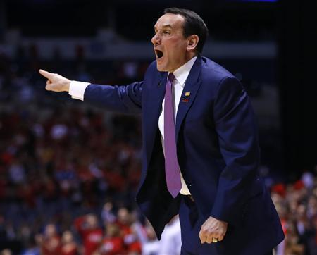 Duke Blue Devils head coach Mike Krzyzewski yells instructions to his team in the first half during their Midwest Regional NCAA men's basketball game against the Louisville Cardinals in Indianapolis, Indiana, March 31, 2013. REUTERS/Jeff Haynes