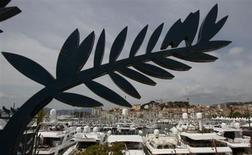 Luxury yachts are moored in the port of Cannes next to the Festival Palace on the eve of the opening of the 65th Cannes Film Festival, May 15, 2012. REUTERS/Christian Hartmann