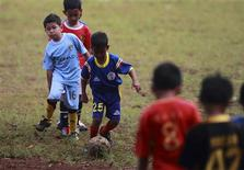 Children attend a training session of the Bogor government soccer school at Pajajaran stadium in Bogor March 10, 2013. REUTERS/Beawiharta