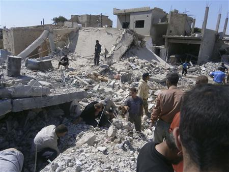 Civilians search for survivors under rubble after what activists said was shelling by forces loyal to Syria's President Bashar al-Assad, in Qusair town near Homs, May 21, 2013. Trad al-Zouhouri/Shaam News Network/Handout via Reuters