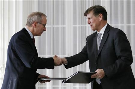 Swiss Secretary of State in the finance department Michael Ambuehl (L) and Donald Sternoff Beyer, the U.S. ambassador to Switzerland, shake hands after signing the signed Foreign Account Tax Compliance Act (FATCA) agreement between the U.S. and Switzerland in Bern February 14, 2013. REUTERS/Pascal Lauener