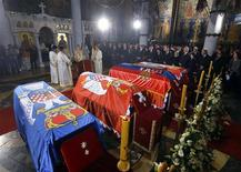 The coffins of Serbian King Petar II Karadjordjevic and his wife Queen Aleksandra, mother Queen Maria and brother Prince Andrej lie inside the St. George's Church on Oplenac Hill during their funeral in Topola, some 71km (44 miles) south from capital Belgrade May 26, 2013. REUTERS/Marko Djurica