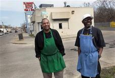Kevin Ward (R) and Charlie Monagan, co-owners of Slabbee's Ribs & Soul, stand in front of their recently opened take-out rib joint in one of Detroit's poorest, blighted neighborhoods in Detroit, Michigan, April 17, 2013. REUTERS/Rebecca Cook