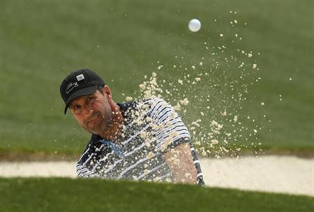Former champion Jose Maria Olazabal of Spain hits from a sand trap on the 18th green during first round play in the 2013 Masters golf tournament at the Augusta National Golf Club in Augusta, Georgia, April 11, 2013. REUTERS/Brian Snyder