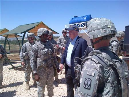 U.S. Senator John McCain (R-AZ) is pictured with U.S. troops at a Patriot missile site in southern Turkey on May 27, 2013 in this picture released via McCain's Twitter account. REUTERS/Senator JohnMcCain/Handout