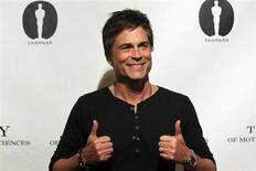 """Cast member Rob Lowe poses before a screening and panel discussion for the reunion of the cast of the 1992 movie """"Wayne's World"""" at the Academy of Motion Picture Arts and Sciences in Beverly Hills, California April 23, 2013. REUTERS/Mario Anzuoni"""