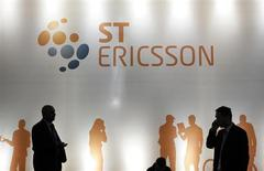 People walk past an ST-Ericsson stand at the Mobile World Congress in Barcelona February 25, 2013. REUTERS/Albert Gea