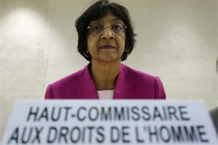 U.N. High Commissioner for Human Rights Navi Pillay arrives for the urgent debate of the Human Rights Council on ''the deteriorating situation of human rights in the Syrian Arab Republic and the recent killings in Al Qusayr'' at the United Nations European headquarters in Geneva May 29, 2013. REUTERS/Denis Balibouse