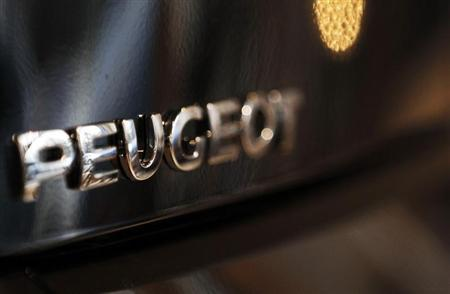 The word Peugeot is displayed on an automobile at a car dealership in Bordeaux, Southwestern France, February 12, 2013. REUTERS/Regis Duvignau