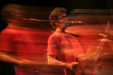 """U.S. rock singer-songwriter and guitarist Lou Reed performs during a concert celebrating the 35th year since the release of the """"Berlin"""" album, in Malaga, southern Spain July 21, 2008. Picture taken with a long exposure. REUTERS/Jon Nazca"""