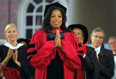 Media mogul Oprah Winfrey acknowledges the cheers from students and audience as she receives an honorary Doctor of Laws degree during Harvard University's 362nd Commencement Exercises in Cambridge, Massachusetts May 30, 2013. REUTERS/Brian Snyder