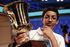 Arvind Mahankali of New York holds his trophy after winning the National Spelling Bee at National Harbor in Maryland May 30, 2013. REUTERS/Kevin Lamarque