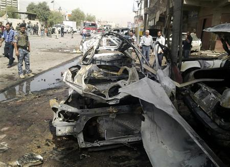 Iraqi security personnel inspect the site of a bomb attack in Baghdad, May 30, 2013. REUTERS/Thaier al-Sudani
