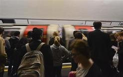 Commuters wait to board a tube train at Holborn Underground Station in London July 18, 2012. REUTERS/Ki Price