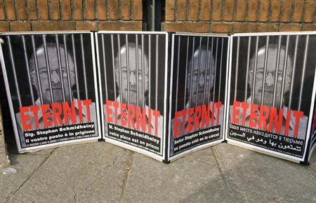 Posters reading ''Stephan Schmidheiny your place is in prison'' are displayed outside the courthouse during a trial against the Swiss firm Eternit's Italian plant in Turin February 13, 2012. REUTERS/Giorgio Perottino