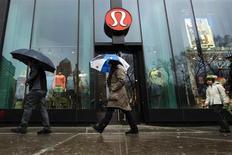 Pedestrians walk past a Lululemon Athletica store in New York, March 19, 2013. REUTERS/Lucas Jackson