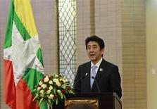 Japan's Prime Minister Shinzo Abe speaks before lunch with Myanmar's President Thein Sein at the Myanmar International Convention Centre in Naypyitaw May 26, 2013. REUTERS/Soe Zeya Tun
