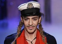 British designer John Galliano appears at the end of his Spring/Summer 2011 women's collection during Paris Fashion Week in this October 1, 2010 file photo. REUTERS/Benoit Tessier/Files