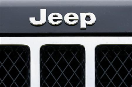 The logo on the front of a Jeep vehicle is shown at a Chrysler dealership in Carlsbad, California April 29, 2013. REUTERS/Mike Blake/Files