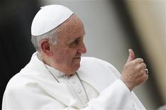 Pope Francis shows a thumbs-up sign as he arrives to lead his Wednesday general audience in Saint Peter's Square at the Vatican June 5, 2013. REUTERS/Max Rossi
