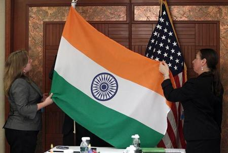 Technical Sergeants from the U.S. Department of Defense display the flags of India and the United States before a bilateral meeting during the Shangri-La Dialogue Asia Security Summit in Singapore June 4, 2010. REUTERS/Carolyn Kaster/Pool/Files