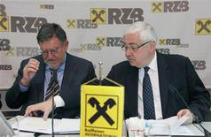 Former Raiffeisen Bank International CEO Herbert Stepic (L) and Chairman Walter Rothensteiner address a news conference in Vienna in this April 20, 2010 file photo. REUTERS/Leonhard Foeger/Files