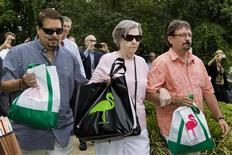 """Gloria C. Mackenzie, an 84-year-old woman from Zephyrhills, Florida (C), her son Scott (R) and a person identified by Lottery Officials as """"a trusted family friend"""" (L) leave the Florida Lottery offices after claiming the largest single jackpot in American lottery history, valued at $590 million, in Tallahassee, June 5, 2013. REUTERS/Colin Hackley"""
