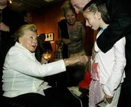 """Film legend Esther Williams greets an admiring fan during a reception at the Academy of Motion Picture Arts and Sciences to screen the re-mastered digital presentation of the 1974 film, """"That's Entertainment,"""" in Beverly Hills September 17, 2004. REUTERS/Jeff Mitchell"""