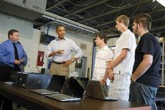 U.S. President Barack Obama speaks with students in the computer lab at Bluestone High School in Skipwith, Virginia, October 18, 2011. REUTERS/Jason Reed