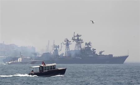 A Turkish Navy cost guard boat (L) escorts the Russian Navy destroyer Smetlivy, in the Bosphorus in Istanbul July 11, 2012. REUTERS/Murad Sezer