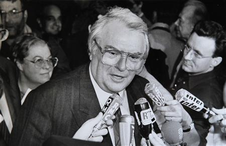 File photo of French Socialist Party First Secretary Pierre Mauroy who speaks to journalists in Paris July 1, 1989. Mauroy has died aged 84, French Foreign Minister Laurent Fabius said on June 7, 2013. Picture taken July 1, 1989. REUTERS/Philippe Wojazer/Files